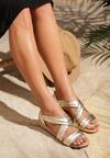 Złote Sandały This World