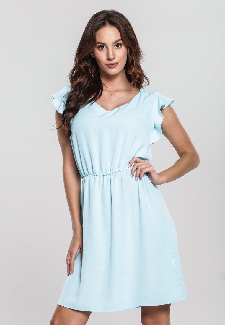 Niebieska Sukienka Distended